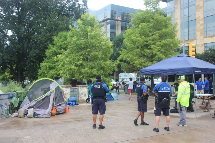 Austin city staff, police and volunteers managed the clearing of a portion of downtown Austin's Cesar Chavez Street homeless encampment Aug. 5. (Ben Thompson/Community Impact Newspaper)