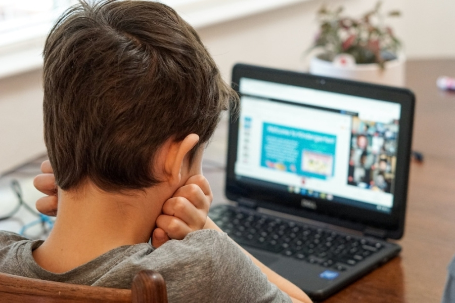 Child in front of a computer.