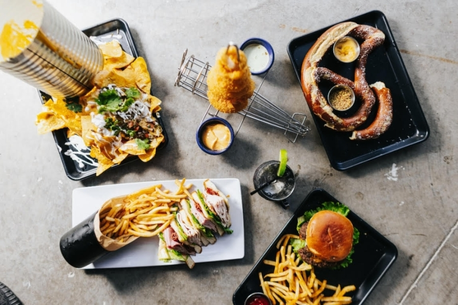 Ace's Sports Hangar menu includes a variety of shareable appetizers and American-style grill options, such as nachos, burgers, wings, and chicken and waffles. (Courtesy Kathy Tran)