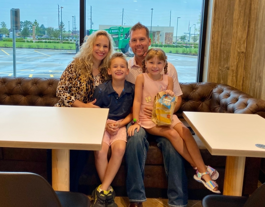 Local McDonald's owner Laurie Glaser-Swift sits with her son, Brandon Swift; husband, Brian Swift; and daughter, Sloane Swift at her now open location. (Courtesy Laurie Glaser-Swift)