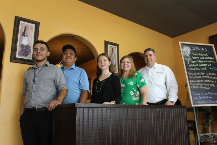 Isaac Rodriguez (right) and his staff serve classic Italian dishes at their two locations. (Photos by Eva Vigh/Community Impact Newspaper)