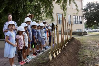 Students from Carl Schurz Elementary and Seele Elementary were in attendance at the event. (Lauren Canterberry/Community Impact Newspaper)