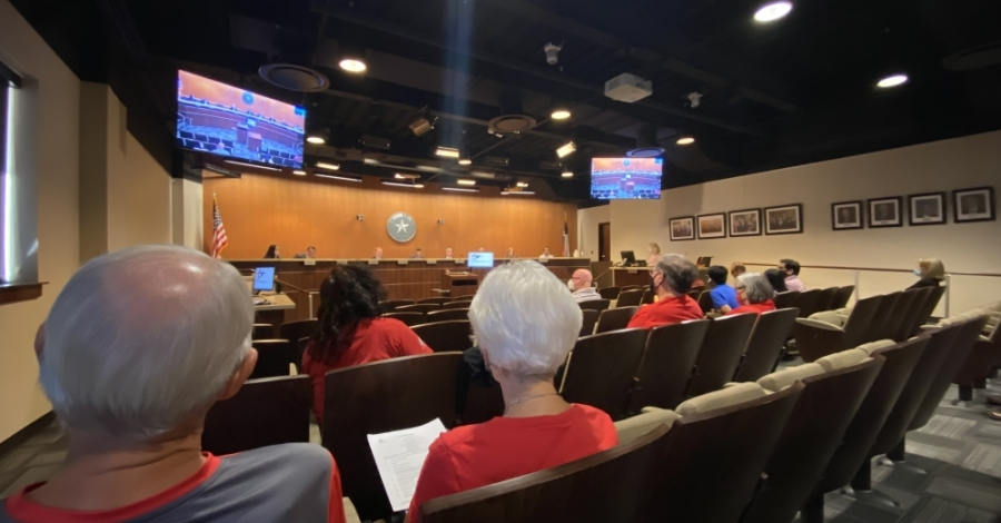 Members of Round Rock Preservation were in the audience of the Aug. 26 City Council meeting, wearing red T-shirts. (Brooke Sjoberg/Community Impact Newspaper)