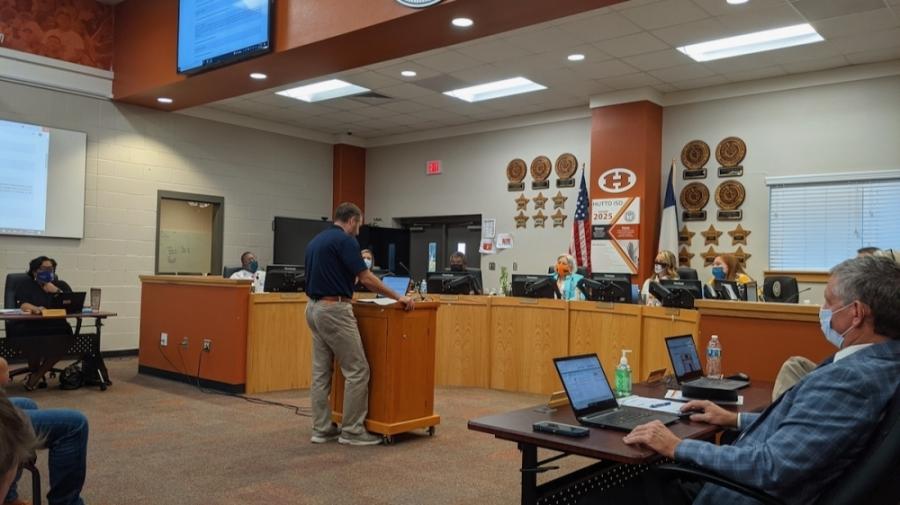 Jason Nichols addresses the Hutto ISD school board. (Carson Ganong/Community Impact Newspaper)