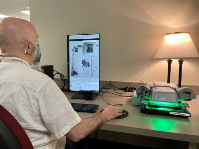 Daniel Sample, manager of FBCL's Genealogy and Local History Department, demonstrates the ScanPro 3000 microfilm scanner in the Genealogy and Local History Department at George Memorial Library in Richmond. (Courtesy Fort Bend County Libraries)