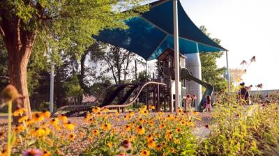 Cottonwood Park now includes two pavilions, a shaded basketball court, play equipment, a splash feature, additional parking, food truck outlets, pedestrian walkways around the park, and additional landscaping and lighting. (Courtesy city of McKinney)