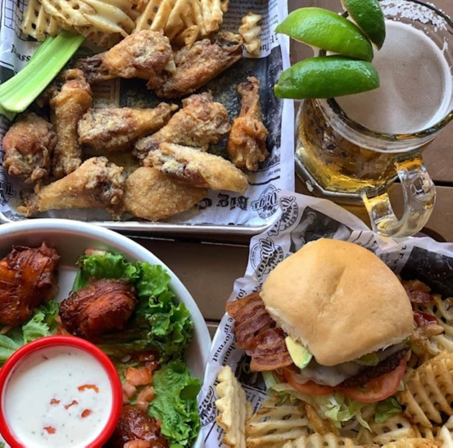 The eatery serves 18 types of wing seasonings and dressings as well as burgers, waffles and loaded baked potatoes. (Courtesy Big City Wings)