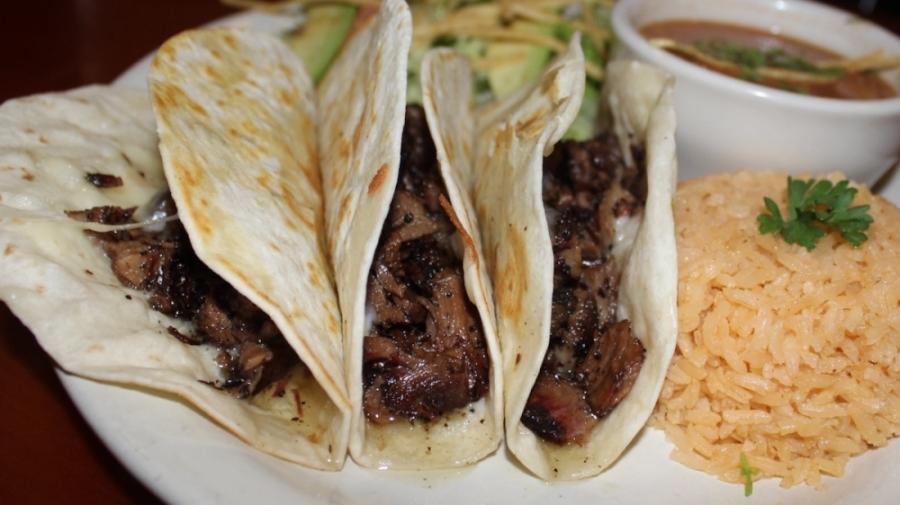 Stiney's Brisket Tacos ($14.99) include smoked Angus brisket and Monterey Jack cheese. (Erick Pirayesh/Community Impact Newspaper)