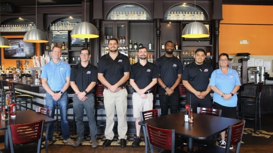 From left, District Manager Mike Akers; General Manager Matthew Sikes; managers Auston Weiss, Robert Westmoreland, Chris McEwen and Christian Galvan; and Kendra Shier, vice president of operations for eight Jakes locations, help run the Frisco location. (Miranda Jaimes/Community Impact Newspaper)
