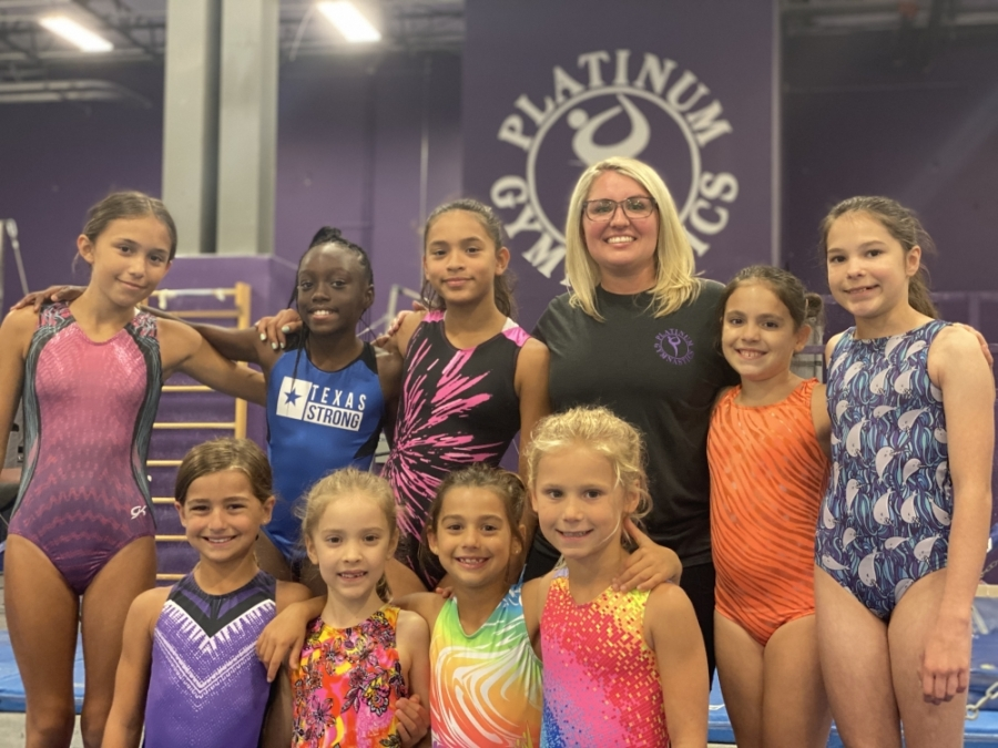 Addyson Martinez (third from right) helps guide young gymnasts daily at her Pflugerville academy. (Photos by Brian Rash/Community Impact Newspaper)