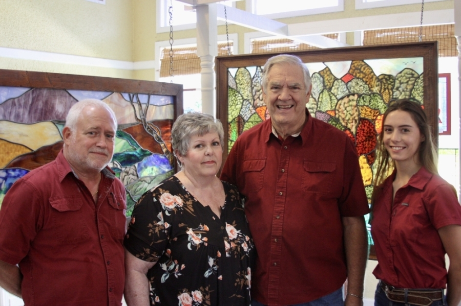 From left, Kevin Shaw, Cindy Whitworth, Jack Whitworth and Sophia Lind create custom stained glass in their New Braunfels studio. (Lauren Canterberry/Community Impact Newspaper)