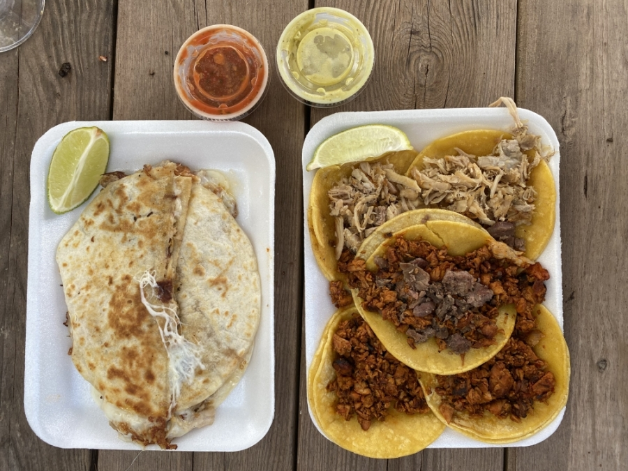 Campechano and pastor tacos, as well as a quesadilla from Dollar Taco. (Eric Weilbacher/Community Impact Newspaper)