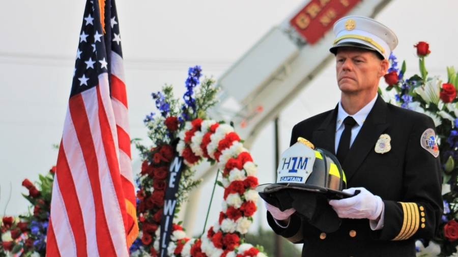 Assistant Fire Chief of Support John Sherwood holds a hazmat helmet from one of the New York Fire Department victims who lost their life on Sept. 11, 2001. (Sandra Sadek/Community Impact Newspaper)