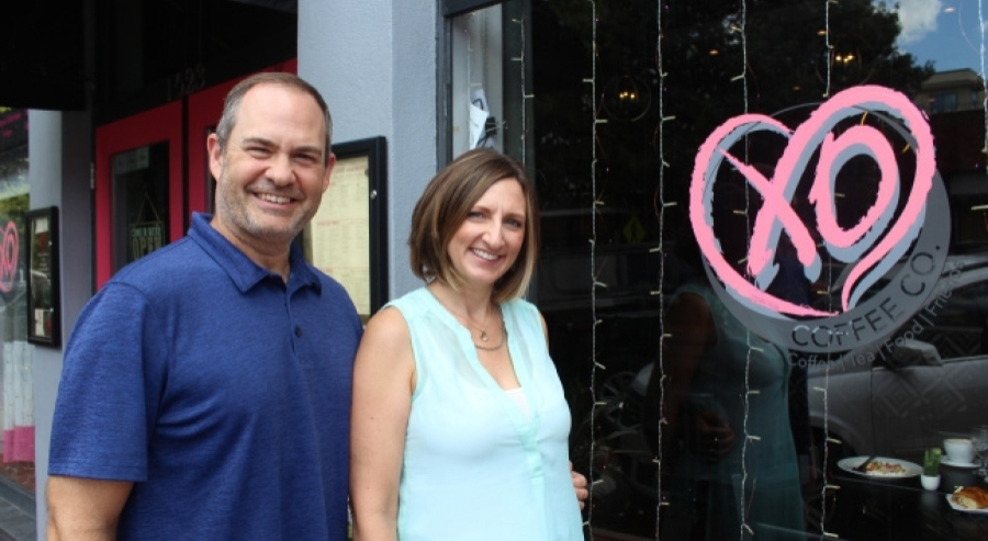 Husband and wife David Martin and Linda McCall own XO Coffee Company in downtown Plano. (Erick Pirayesh/Community Impact Newspaper)