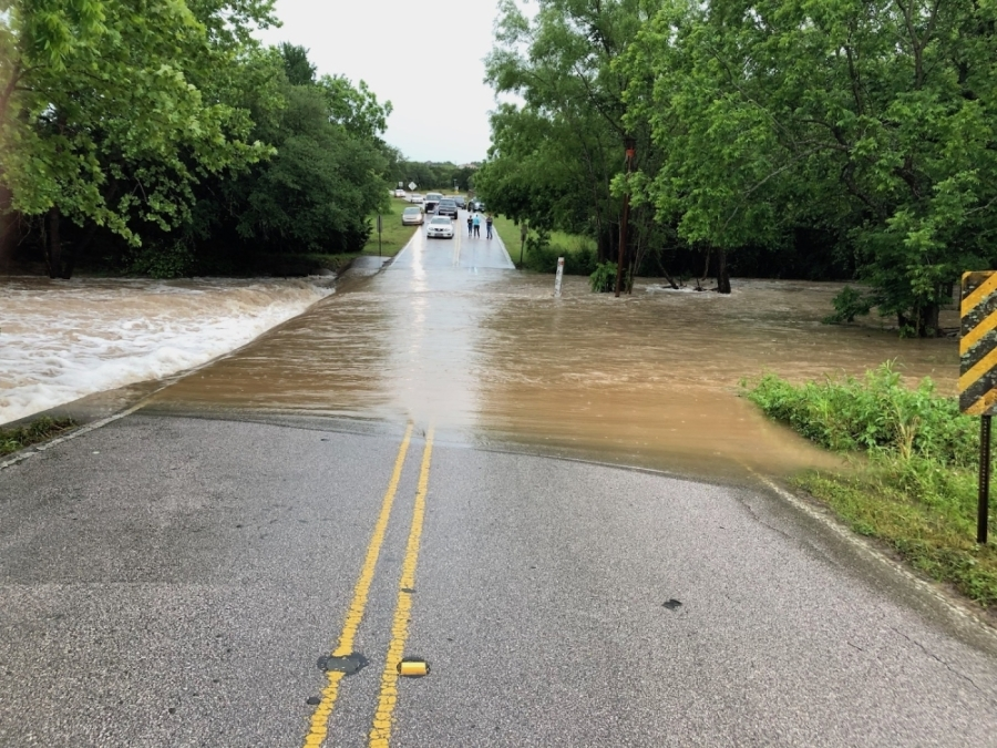 The low-water crossing at Great Divide Drive was flooded by Little Barton Creek in May 2019. Following council action Sept. 14, city staff will now work with an engineering firm to finalize a bridge design. (Courtesy James Cooke)