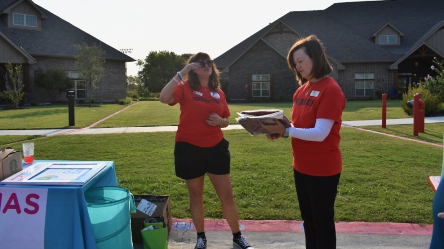 Jo Alch (right), founder and executive director of Pajamas for Seniors, and volunteer Allison Byrd-Haley collect pajama donations at Teresa's House in McKinney. (Brooklynn Cooper/Community Impact Newspaper)