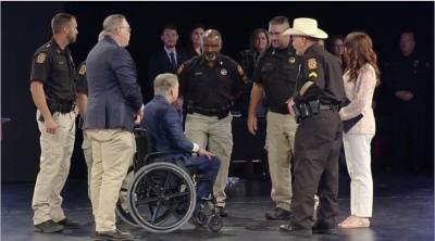 Cpl. Lonnie Bruce Harrison, (right) Gov. Greg Abbott and members of the Montgomery County Constable Precinct 5 Office gather at the Star of Texas Awards where Harrison was a recipient. (Courtesy of Montgomery County Precinct 2 Commissioner Charlie Riley's office)