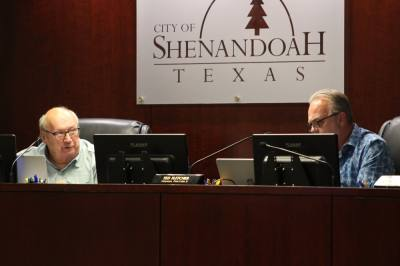 Council members Charlie Bradt (left) and Ted Fletcher (right) discuss asking the city's municipal development district for additional funding during a Sept. 22 meeting. (Andrew Christman/Community Impact Newspaper)