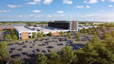 Raytheon Intelligence & Space unveiled plans Sept. 23 to build a new 400,000-square-foot factory, lab and office space at its McKinney campus, scheduled to open in 2025. (Rendering courtesy Raytheon Intelligence & Space)