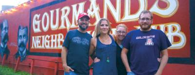 From left: Gourmands Neighborhood Pub owners Mike Russell, Tiffany Russell, Caitlin Shea and Benjamin Siewart opened the East Austin establishment in October 2011.