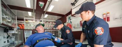 Paramedics Caleb Longino (center) and Taylor Proefrock (right) practice medical scenarios April 29 in one of the city's transitional response vehicles with Travis Vinton (left) at Fire Station No. 5 in Georgetown.
