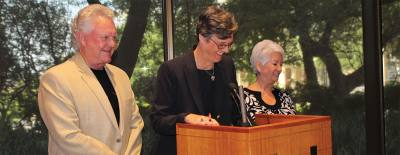 From left: Travis County Commissioner Gerald Daugherty, Travis County Judge Sarah Eckhardt and Travis County Commissioner Brigid Shea stand at the podium for a news conference Aug. 18 following a vote to call for a Nov. 3 bond election for new civil and family courts facilities.