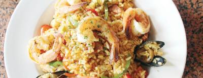 The lunch entree Coast Paella ($13) includes shrimp, crawfish, mussels, calamari and sausage.