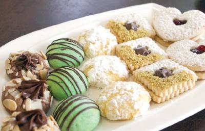 The bakery makes cookies such as a green French mint macaron and coconut lemon.