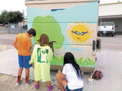Texas teens work on a wall art display