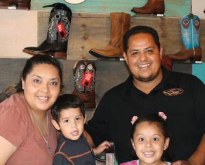Jireh Boots is a family affair, co-owned by Elvia and Tony Hernandez, shown here with their two children. They have lived in Pflugerville for nine years.