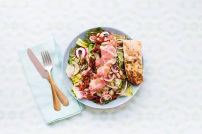 Modern Marketu2019s Toscano Salad includesnprosciutto, roasted grape tomatonand cucumber.