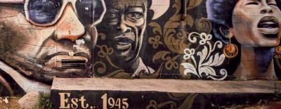 A mural is located in the African American Cultural Heritage District in Austin.