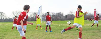 Professional coaches teach fundamentals of soccer and help players improve their existing skills.