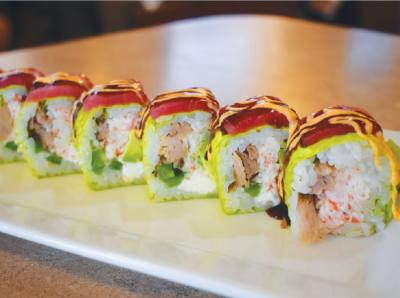 The land and sea roll [$13.99] at Q-Shi includes crab, smoked rib meat, cream cheese and avocado.