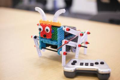 A student built a remote-controlled Lego robot at Code Ninjas.