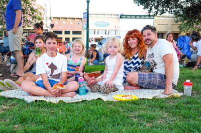 Families enjoy the Music on the Square summer concert series in Georgetown.