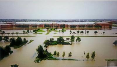 Water surrounds Cypress Ranch High School on Fry Road. CFISD officials will conduct an assessment of all district facilities after flood conditions improve.