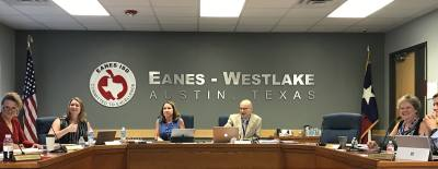 Eanes ISD Board discusses agenda items at a recent meeting.