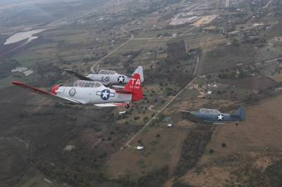 Three planes settle into fingertip formation. As part of the Texas Veteran Liberators Project held at the capitol on Nov. 9, four WWII era planes did a flyover.