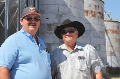 Ken (left) and Larry started their rice farm in 1999.