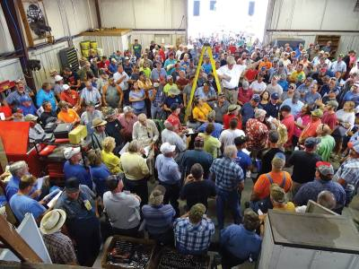 A crowd gathers during a live auction in Sparta, Tenn. on Aug. 26, 2017.