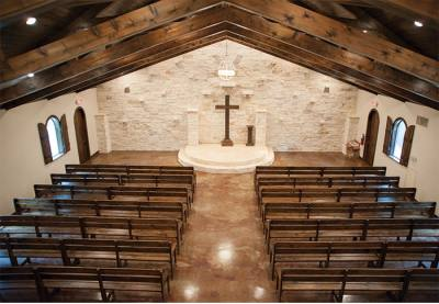 The chapel is made of rustic stone and wood and seats 220 guests.
