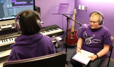 Emily Freeman records an original song at Purple Songs Can Fly, located at Texas Children's Hospital-West Campus in Katy.