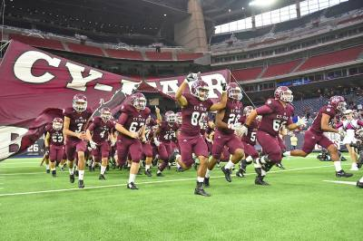 The Cy-Fair High School football enters the field during its Class 6A Division II state semifinal playoff against Austin Westlake on Dec. 16 at NRG Stadium. The Bobcats beat Westlake 14-6 to advance to its first-ever state championship game.