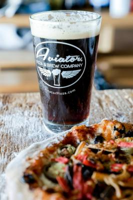 To celebrate its one-year anniversary, Aviator Pizza & Brew Company will give away 20 free beers on Saturday, Dec. 16.