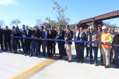 Several elected officials came to the ribbon cutting for the Post Road bridge opening.
