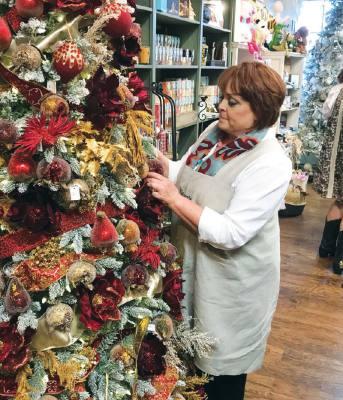 Nikki Mackenzie decorates Magpie Blossom Boutique, 900 S. RM 620, Ste. B104, Lakeway.