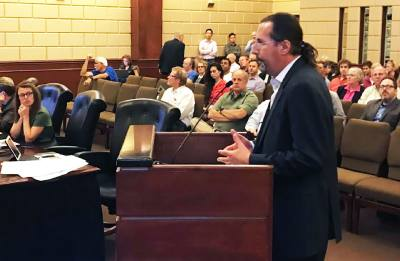 The Backyard developer Chris Milam addressed the City Council at its Nov. 28 meeting.  A number of Bee Cave residents expressed opinions at the podium.