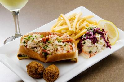 One of Sea Breeze Lobsta & Chowda House's food items includes its lobster roll.