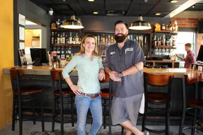 From left: Caitlin and Chad Niland opened the Downtowner in December 2016, offering high-end comfort food and eclectic bar options.